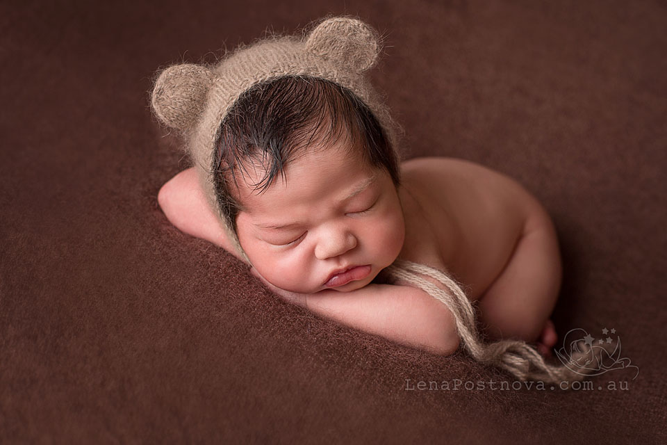 Newborn Baby Photography Sydney - cute long-haired newborn baby wearing bear hat