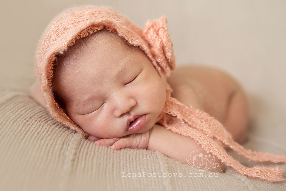 Newborn Photography Sydney Northern Beaches - portrait of 2 weeks old baby  girl in cute pink bonnet Newborn_Photography_Sydney_Newborn_Photographer_Lena_Postnova_Newborn_Baby_Girl_12_days_old